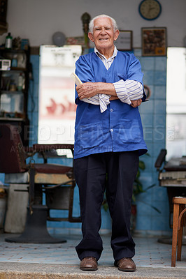 Buy stock photo Shot of a senior man in his barber shop