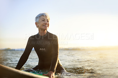 Buy stock photo Cropped shot of a senior woman surfing
