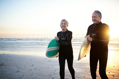 Buy stock photo Shot of a senior married couple coming from surfing