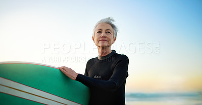 Buy stock photo Cropped shot of a senior woman going surfing