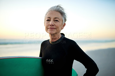 Buy stock photo Portrait of a senior woman going surfing