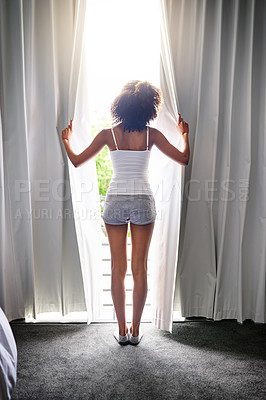 Buy stock photo Rearview shot of an unrecognizable woman opening her bedroom curtains after waking up from sleeping