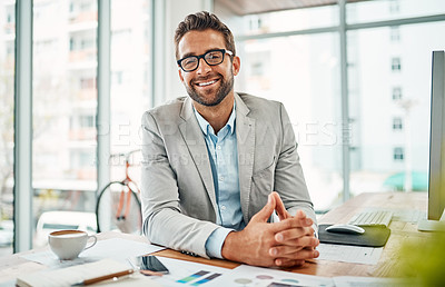 Buy stock photo Portrait of a handsome young businessman sitting in an office