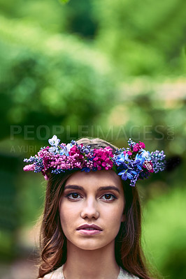 Buy stock photo Cropped shot of a beautiful young woman wearing a floral head wreath posing in nature
