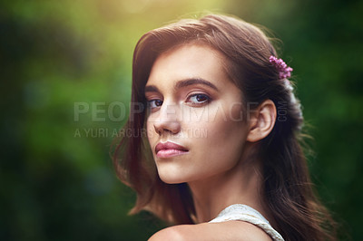 Buy stock photo Cropped shot of a beautiful young woman posing in nature
