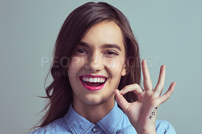 Buy stock photo Studio portrait of an attractive young woman making an