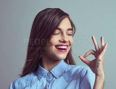 Buy stock photo Studio shot of an attractive young woman making an