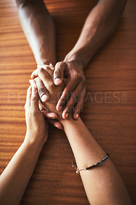 Buy stock photo High angle shot of two unrecognizable people holding hands