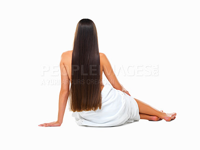 Buy stock photo Rearview studio shot of a young woman with long silky hair against a white background