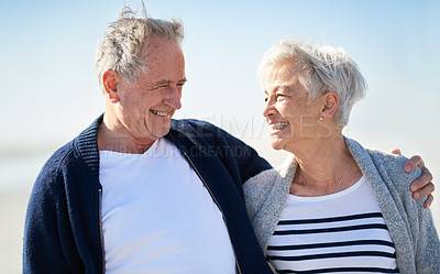 Buy stock photo Shot of a happy senior couple spending a day at the beach
