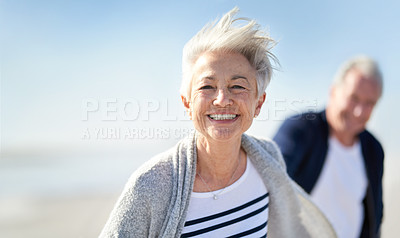Buy stock photo Portrait of a happy senior couple having fun at the beach