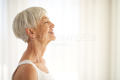 Buy stock photo Cropped shot of a happy senior woman at home