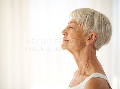 Buy stock photo Cropped shot of a content senior woman at home