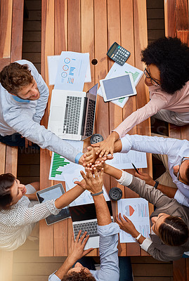 Buy stock photo High angle shot of a group of businesspeople high fiving during a meeting outdoors