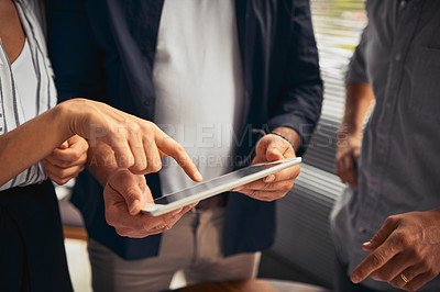 Buy stock photo Cropped shot of unrecognizable businesspeople working together and using a tablet in the office