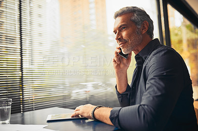 Buy stock photo Cropped shot of a mature businessman on a call in the office