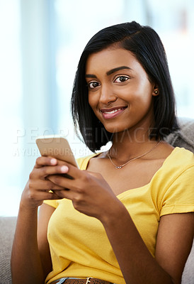 Buy stock photo Portrait of a teenage girl using a cellphone at home