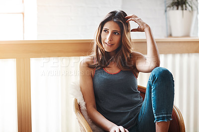 Buy stock photo Shot of an attractive young woman relaxing at home