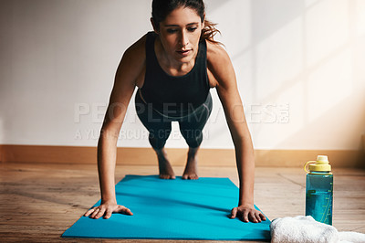Buy stock photo Shot of an attractive young doing pushups at home
