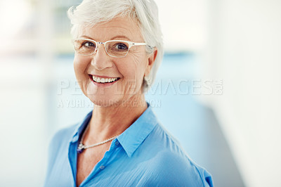 Buy stock photo Cropped portrait of a senior woman standing in her home