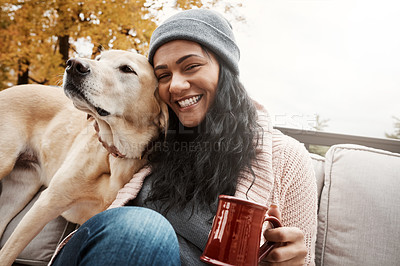 Buy stock photo Shot of a young woman relaxing with her dog outside