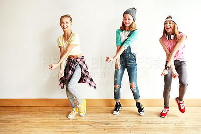 Buy stock photo Shot of young girls dancing in a dance studio
