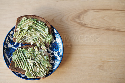 Buy stock photo Still life shot of avocado on toasted bread served on a plate