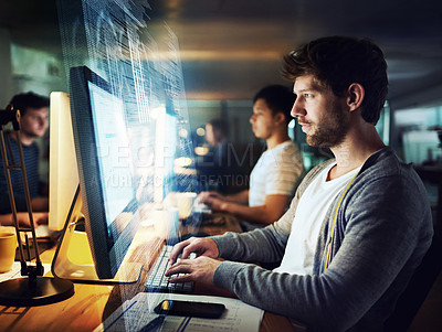 Buy stock photo Shot of a programmer working on a computer code at night
