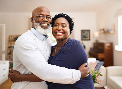 Buy stock photo Portrait of a happy mature couple in a loving embrace at home