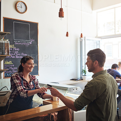 Buy stock photo Shot of a customer making a credit card payment in a cafe