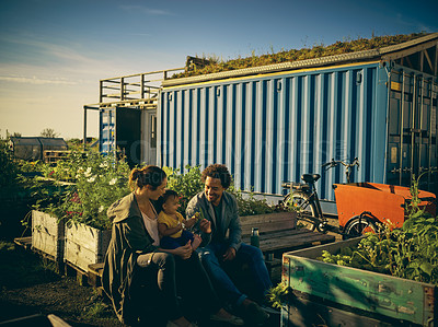 Buy stock photo Shot of a young family at a farmer's market