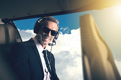 Buy stock photo Portrait of a mature businessman traveling in a helicopter
