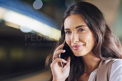 Buy stock photo Cropped shot of a young attractive woman on a call and using the train to commute