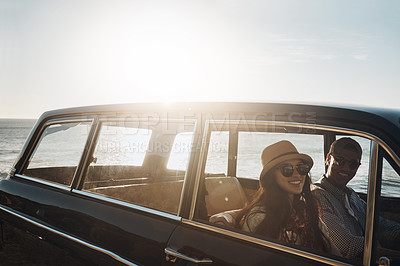 Buy stock photo Portrait of a young couple enjoying a road trip along the coast