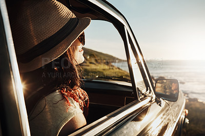 Buy stock photo Shot of a young woman enjoying a road trip along the coast