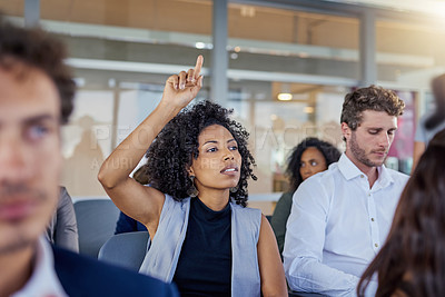 Buy stock photo Shot of a young businesswoman raising her hand during a presentation in an office