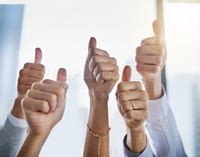 Buy stock photo Closeup shot of an unrecognizable group of businesspeople showing thumbs up in an office
