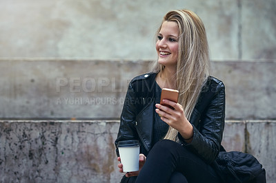 Buy stock photo Shot of an attractive woman using a mobile phone in the city