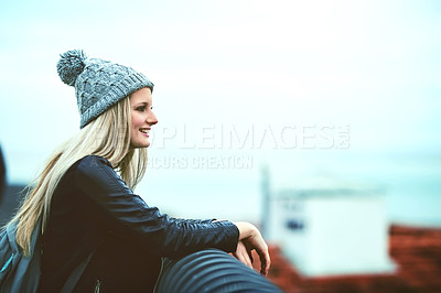 Buy stock photo Shot of a young woman looking at the city view from a bridge