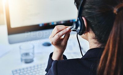 Buy stock photo Rearview shot of a young woman working in a call centre