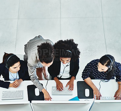 Buy stock photo High angle shot of a group of women working in a call centre