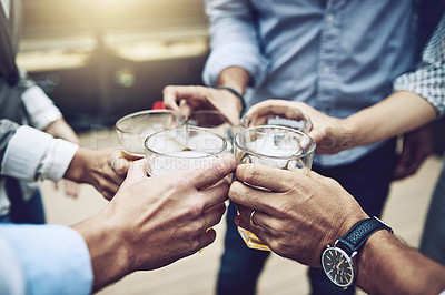 Buy stock photo Shot of a group of unrecognizable work colleagues having a celebratory toast together with beer outside during the day