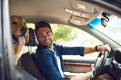 Buy stock photo Cropped shot of a handsome young man taking a drive with his dog in the backseat