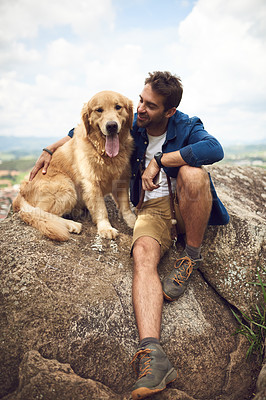 Buy stock photo Full length shot of a handsome young man and his dog taking a break during a hike in the mountains