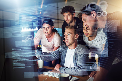 Buy stock photo Shot of a group of young people using a computer with a virtual screen during a late night at work