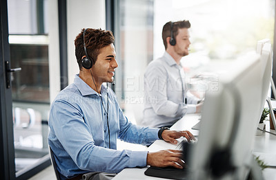 Buy stock photo Shot of two handsome young men working in a call center