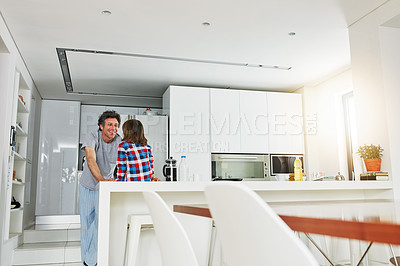 Buy stock photo Shot of a mature father and his young son in the kitchen at home