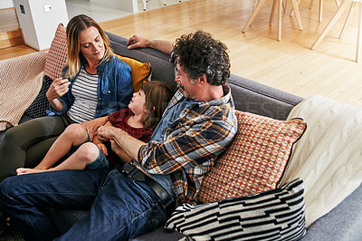 Buy stock photo Cropped shot of an affectionate family of three relaxing on the sofa at home