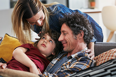 Buy stock photo Cropped shot of an adorable little boy resting on his mature father's chest on the sofa at home