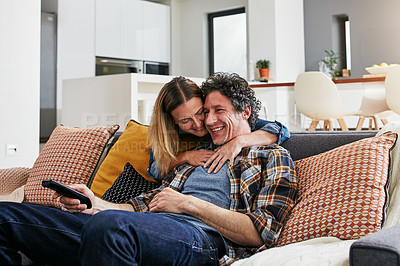 Buy stock photo Cropped shot of a mature married couple relaxing on the sofa at home